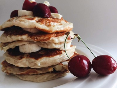 Healthy pancakes with white chocolate and cherries